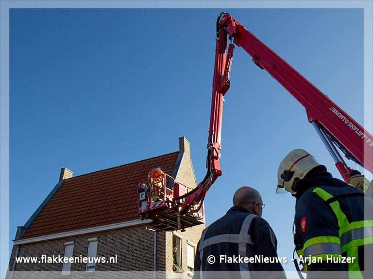 Foto behorende bij Hoogwerker assisteert ambulance
