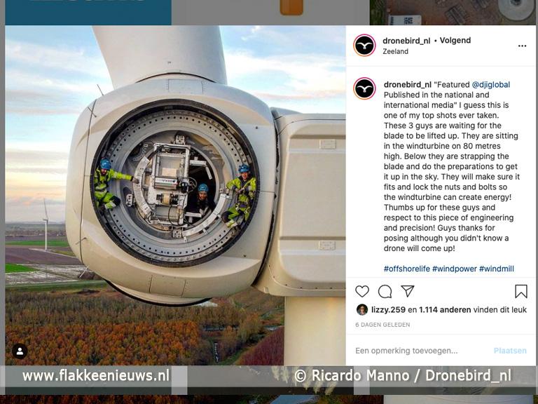 Foto behorende bij Foto windmolenmonteurs Oude-Tonge gaat de wereld over